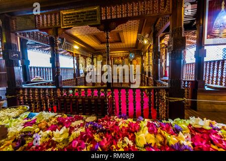 Prayer offerings outside the chamber holding the Sacred Tooth, Temple of the Sacred Tooth Relic (Sri Dalada Maligawa), Kandy, Central Province, Sri - Stock Photo