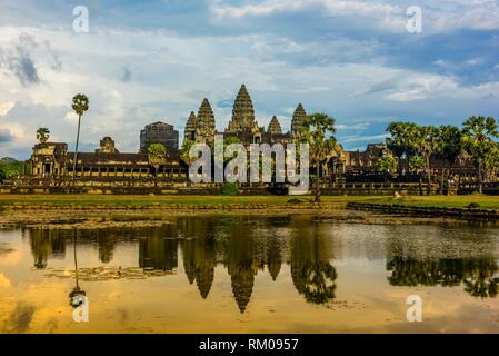 View of Angkor Wat with pond. It is the largest religious monument in the world. It's name means City which is a temple; Cambodia. - Stock Photo
