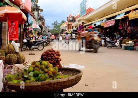 Preah Sihanouk street. Street Market (Psar) of Kratie, Cambodia. - Stock Photo