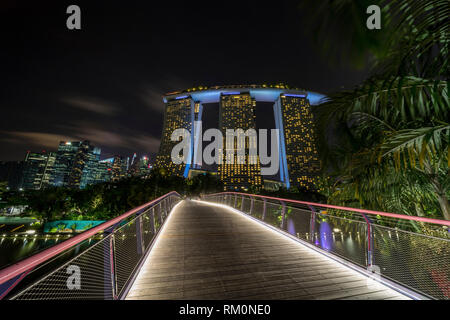 Marina Bay Sands overlooks the lush tropical Gardens by the Bay in Singapore.