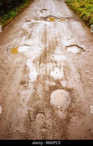 Muddy wet dirt road, Medstead, Hampshire, England, United Kingdom. - Stock Photo