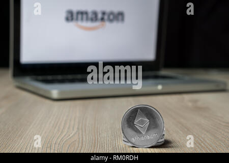 Ethereum coin with the Amazon logo on a laptop screen, Slovenia - December 23th, 2018 - Stock Photo