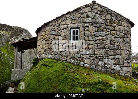 Cabin over a big rock in Monsanto, Castelo Branco, Portugal. - Stock Photo