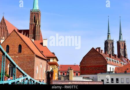 Tumski bridge over Oder river, church of Saint Peter and Saint Paul, church of Saint Cross and cathedral in Wroclaw or Breslau, Poland. - Stock Photo