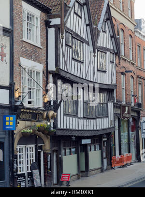 The Golden Fleece Pub and the house in front of Lady Pecketts Yard provide good examples of medieval architecture. - Stock Photo