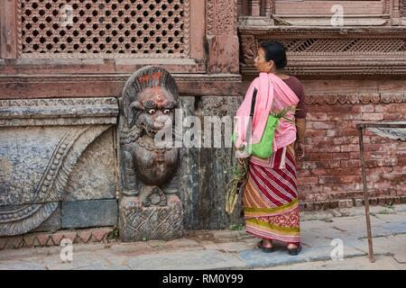 Woman and demon, Durbar Square, Kathmandu, Nepal. - Stock Photo