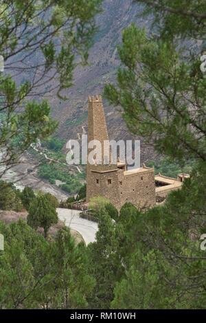 Ancient Qiang stone watchtower in the Tibetan village of Jiaju, Sichuan, China. - Stock Photo