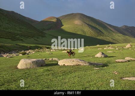 Kyrgyz horserider, Jyrgalan Valley, Kygyzstan. - Stock Photo
