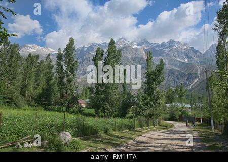 High alpine peaks behind the walnut village of Arslanbob, Kygyzstan. - Stock Photo