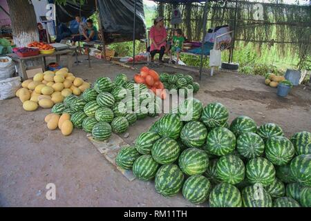 Watermelons for sale by the roadside, Osh, Kygyzstan. - Stock Photo
