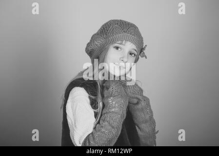 Fashion little girl child wearing a hat and clothes standing in studio - Stock Photo