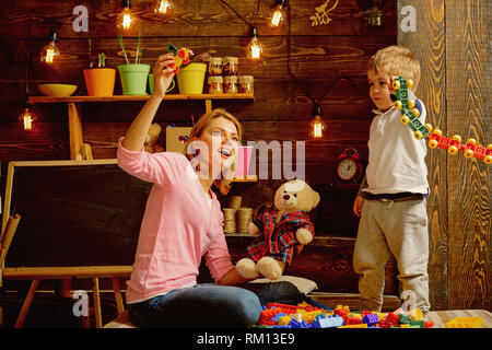 Daycare concept. Little child play daycare game with woman. Daycare preschool. Family daycare. Fun place to play and learn - Stock Photo