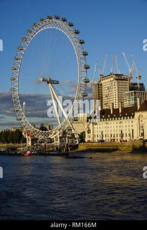 The London Eye, the County Hall on Queen's Walk and the river Thames. London, England, Great Britain, Europe. - Stock Photo