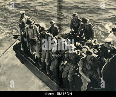 """Return of a landing party of Royal Marines, World War II, c1939-c1943 (1944). From """"The Royal Marines - The Admiralty Account of Their Achievement 1939-43"""". [His Majesty's Stationery Office, London, 1944]. - Stock Photo"""