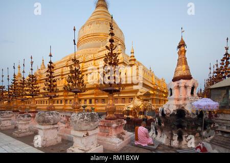 Shwezigon pagoda, Nyaung-U village, Bagan village area, Mandalay region, Myanmar, Asia - Stock Photo