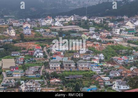 View over the rooftops of Dalat, Central Highlands, Vietnam, Asia - Stock Photo