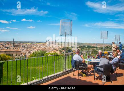 People at the terrace and overview of the town. Parador, Toledo, Spain. - Stock Photo