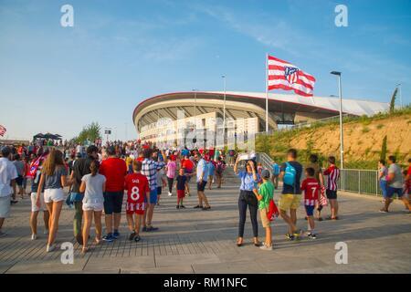People at Wanda Metropolitano stadium before football match. Madrid, Spain. - Stock Photo