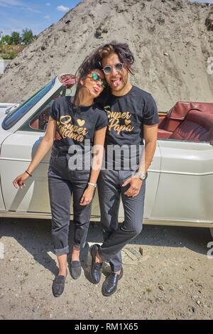 Couple at luxus oldtimer. Cool attitude. Turkish ethnicity. High society. Bloggers Adem Bayalan and Emine Feruz Bayalan. Bavaria, Germany. - Stock Photo