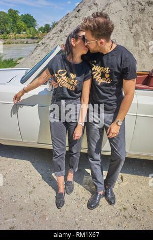Couple kissing at luxus oldtimer. Turkish ethnicity. High society. Bloggers Adem Bayalan and Emine Feruz Bayalan. Bavaria, Germany. - Stock Photo