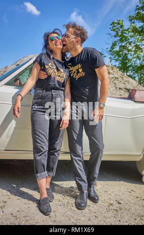 Couple at luxus oldtimer. Turkish ethnicity. High society. Bloggers Adem Bayalan and Emine Feruz Bayalan. Bavaria, Germany. - Stock Photo