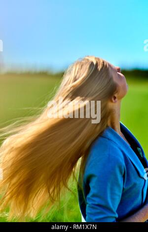 Woman shaking hair. Waakirchen, Bavaria, Germany.