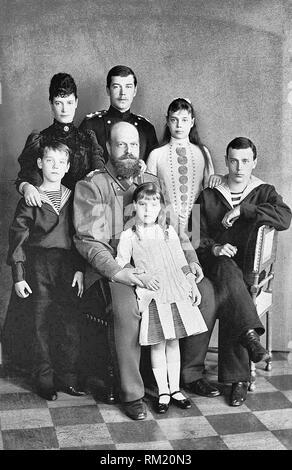 Photograph of Alexander III, Emperor of Russia (1845-94) and his consort Maria Feodorovna, Empress of Russia (1847-1928) with their children Tsesarevich Nicholas (1868-1918), later Nicholas II, Grand Duke George Alexandrovich (1871-99), Grand Duchess Xenia Alexandrovna (1875-1960), Grand Duke Michael Alexandrovich (1878-1918) and Grand Duchess Olga Alexandrovna (1882-1960). Circa 1889 - Stock Photo