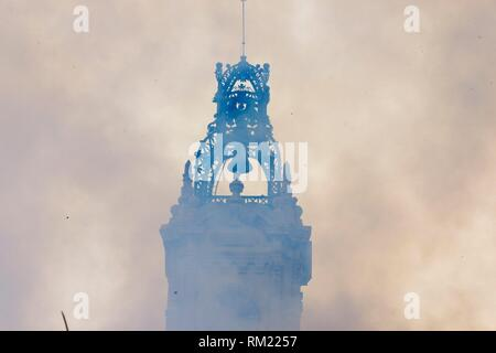 The smoke of the rockets prevents to see the city council of Valencia during the traditional Mascleta - Stock Photo