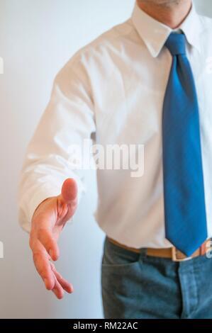 Man extending his open hand offering handshake. - Stock Photo