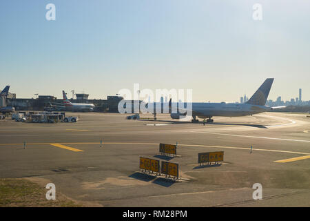 NEW YORK - APRIL 05, 2016: airplane at LaGuardia Airport. LaGuardia Airport is an international airport located in the northern part of Queens, New Yo - Stock Photo