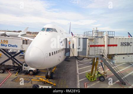 NEW YORK - APRIL 06, 2016: passenger jet airplane docked at JFK Airport. John F. Kennedy International Airport is a major international airport locate - Stock Photo
