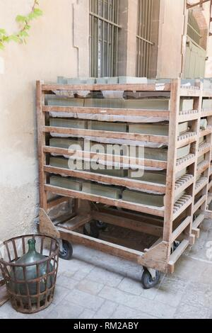 Mellow green blocks of olive Marseille soap on traditional wooden racks drying in the sun outside the Marius Fabre soap factory, Salon, Provence, - Stock Photo