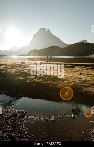 Just insane the view of the pic du midi from the Ayous lakes. Is one of the best sunrises that i`ve ever seen. - Stock Photo