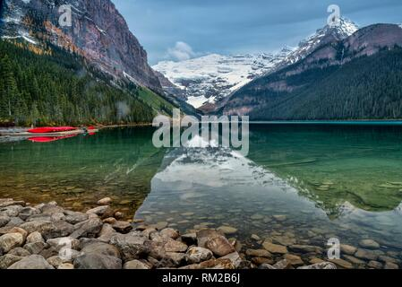 Glassy Smooth Lake Louise on a Fall Morning in Banff National Park Alberta Canada.