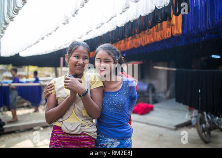MANDALAY, MYANMAR - JANUARY 11, 2016: Unidentified women in a small silk factory on the outskirts of Mandalay, Myanmar on January 11, 2016 - Stock Photo