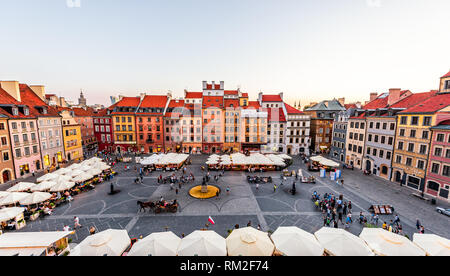 Warsaw, Poland - August 22, 2018: Historic cityscape panorama with high angle view of colorful architecture rooftop buildings in old town market squar - Stock Photo