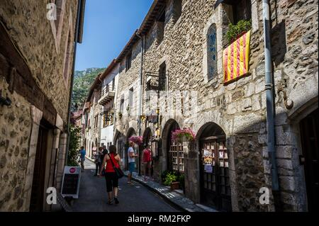 Flag of Roussillon in a medieval street, Villefranche-de-Conflent (department of Pyrénées-Orientales, region of Occitanie, France). - Stock Photo