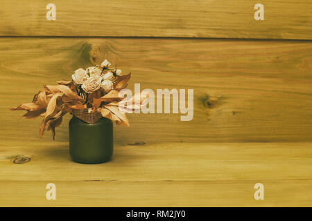 Vase with dried flowers on wooden table.Toned photo. - Stock Photo