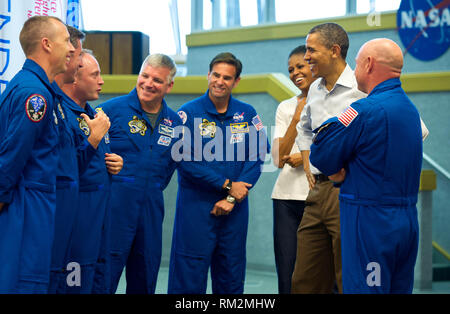 United States President Barack Obama and First Lady Michelle Obama meet with STS-134 space shuttle Endeavor commander Mark Kelly, right, and shuttle astronauts, from left, Andrew Feustel, European Space Agency's Roberto Vittori, Michael Fincke, Gregory H. Johnson, and Greg Chamitoff, after their launch was scrubbed, Friday, April 29, 2011, at Kennedy Space Center in Cape Canaveral, Florida..Mandatory Credit: Bill Ingalls / NASA via CNP /MediaPunch - Stock Photo