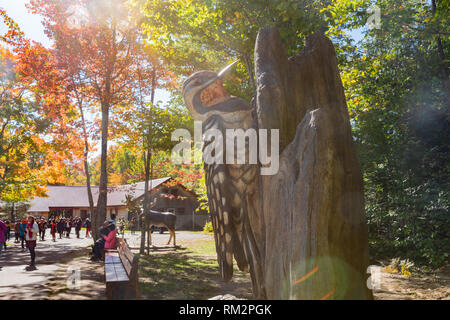 Quebec, OCT 3: Big wooden woodpecker statue in Montmorency Falls on OCT 3, 2018 at Quebec, Canada - Stock Photo