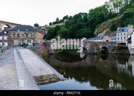 Dinan, France - July 23, 2018: View of medieval bridge over river Rance in the harbour of the city of Dinan in French Brittany - Stock Photo