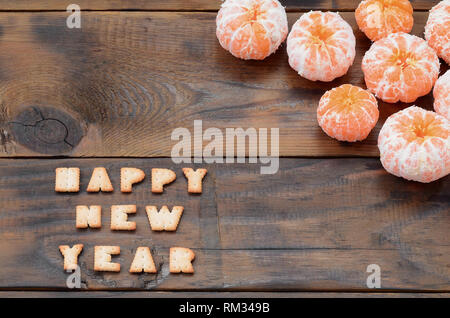 Christmas holiday card with tangerines, cracker text with copy space. Top view, flat lay - Stock Photo