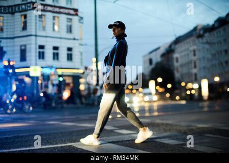woman walking on street in Berlin, Germany