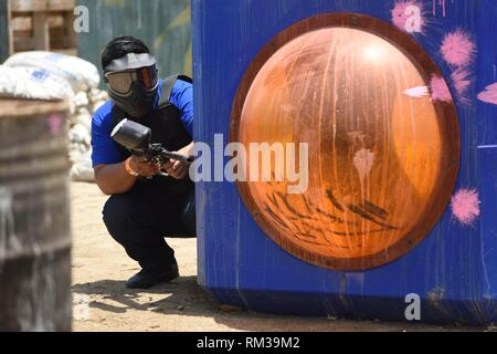 The running person with a gun for pinball - Stock Photo