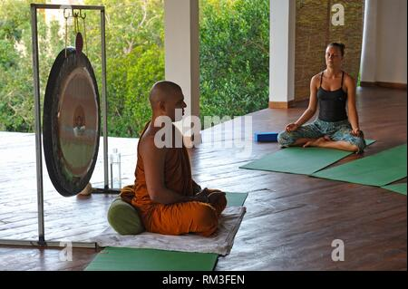 meditation session with a Buddhist monk at Sen Wellness Sanctuary, near Tangalle, South Coast of Sri Lanka, Indian subcontinent, South Asia. - Stock Photo
