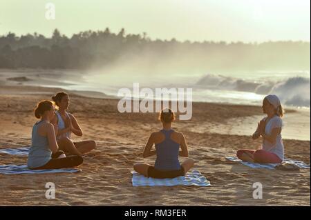 yoga class on the beach beside the Sen Wellness Sanctuary, near Tangalle, South Coast of Sri Lanka, Indian subcontinent, South Asia. - Stock Photo