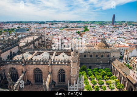 Looking down on Seville Cathedral from the church's 11th century Giralda. Built on the site of the Moorish 12th century Almohad mosque, it is one of t - Stock Photo