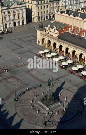Adam Mickiewicz Monument, the Cloth Hall (Sukiennice) and Town Hall Tower seen from the highest tower of the St. Mary´s Basilica, Rynek Glowny, the - Stock Photo