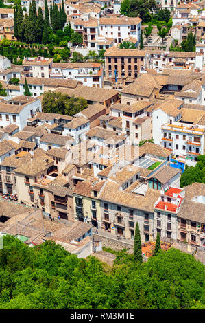 A view over the neighborhood of Albayzin from the Alhambra in Granada, Spain. The city is known for its medieval architecture dating back to the time  - Stock Photo