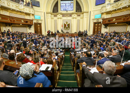 Cairo, Egypt. 13th Feb, 2019. A general view of a plenary session at the Egyptian Parliament held to deliberate the proposed constitutional amendments that will increase the country's President term in office from four to six years. The Parliament members will vote later on the amendments before referring it to the Legislative and Constitutional Affairs Committee to be discussed in detail and to be finalized before being referred to the president to be put up for a public vote in a national referendum. Credit: Lobna Tarek/dpa/Alamy Live News - Stock Photo